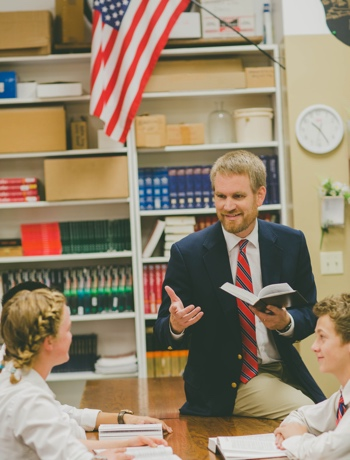 Teacher Talks with Student at Classical School