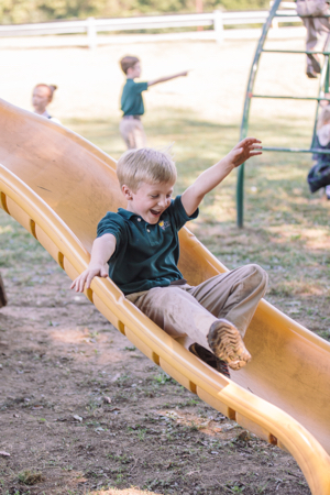 boy on slide Association of Classical Christian Schools (ACCS)