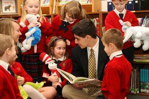 High School and Kindergartners in a Christian School Classroom
